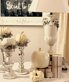 I just put little white pumpkins on a bed of moss on top of my mercury glass candlesticks, added some books bound with webbing and  jute, added a couple more pumpkins and called it done.