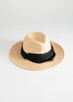 Fedora hat in a woven straw with a solid black band. Straw Fedora, Fedora Hat, Buckingham Palace, Ibiza, Wool Berets, Felt Hat, Hats For Women, Kaftan, Solid Black