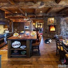 Love this rustic cabin kitchen! Perfect kitchen fire!