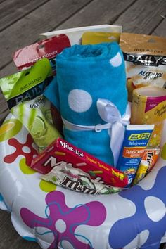 """Summer gift """"basket"""" idea.  Tape a plastic plate to cover the hole and add fun summer items"""
