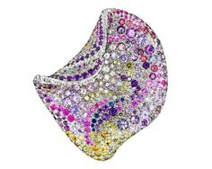 Naomi Sarna multicolored diamond and sapphire petal brooch in white gold.