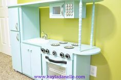 Kayla Danelle: Retro Inspired Play Kitchen from an old cabinet/ entertainment center Diy Kids Kitchen, Red Kitchen, Kitchen Sets, Diy Kids Furniture, Repurposed Furniture, Furniture Makeover, Furniture Projects, Diy Projects, Play Spaces