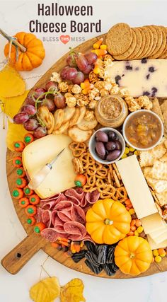 This fun Halloween Cheese Board is tasty & easy to make! Made with cheese, crackers, pumpkins for garnish & lots of Halloween candy. Perfect for parties! Halloween Appetizers, Halloween Food For Party, Halloween Candy, Appetizers For Party, Easy Halloween, Appetizer Ideas, Halloween Countdown, Halloween Magic, Halloween Baking