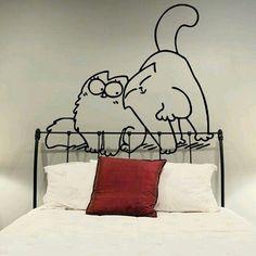 Gatos en la pared