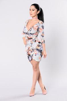 Available in Lavender Floral Printed Dress Surplice Neckline Deep V Back 3/4 Sleeve Mid Rise Length Surplice Hemline 94% Polyester 6% Spandex