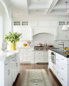 """Updating your kitchen for Spring is simple! Start by adding a beautiful hand-loomed runner in a subtle motif to brighten up the floors. Then create a sunny moment by popping in an accessory in our signature """"sunshine"""" yellow! ☀️ Shop some of our favorites via the link in profile. Image via @betterhomesandgardens #kitchen #inspiration"""