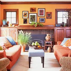 Orange Everywhere This living room is small on space but long on style with orange sofas and orange walls. An unusual complementary color scheme of orange and blue serves to rev up each hue.
