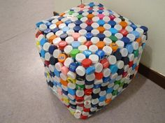 A stool made of bottle caps and plastic trash.