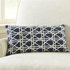 Cane weave detail adds depth to the natural jute fabric of the Emma Lumbar pillow cover.