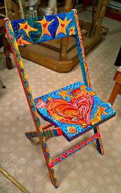 This is an old vintage church folding chair which has been recycled and upcycled into a piece of functional art. This piece is painted in both Painted Folding Chairs, Hand Painted Chairs, Hand Painted Furniture, Funky Furniture, Recycled Furniture, Furniture Upholstery, Painting Furniture, Office Furniture, Windsor