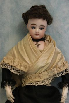 """This French Fashion is by Francios Gaultier, and FG in scroll on one shoulder and 2 on the other shoulder, marked on the back of the head with """"2"""". With a swivel head on a bisque shoulder-plate, has blue set eyes with such a pretty face and accented nostrils, rosy cheeks, and pierced ears.   eBay!"""