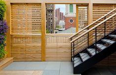 framing the view, teak slat dividers on terrace, bluestone pavers, NYC Nelson, Byrd, Woltz