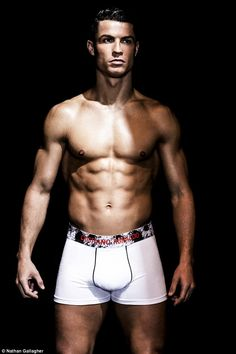 Abs-olutely fabulous! Cristiano Ronaldo shows off his lean physique in a pair of tight whi...