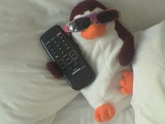 Penguin on vacation with us in Negril Jamaica...the cleaning staff got a kick out of him, we came back to our room after lunch and found him like this. LOL