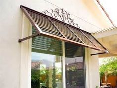 bahama shutters exterior at lowe's – Bing Images – Home Renovation Window Shutters Exterior, Window Awnings, Wood Shutters, House Paint Exterior, Modern Shutters, Bermuda Shutters, Bahama Shutters, Backyard Canopy, Canopy Outdoor