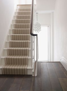 A modern staircase. Stair runner on plain white stairs Painted Floorboards, Painted Stairs, Wooden Stairs, Oak Stairs, Steel Stairs, Concrete Stairs, House Stairs, Carpet Stairs, Wall Carpet
