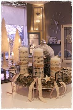 Advent wreath, rustic charm, music sheet candles, wooden stars, moss and snow...  www.skreytumhus.is