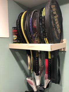 Tennis rack storage with custom ball shelf Sports Storage, Kids Storage, Garage Organization, Organization Ideas, Organizing, Wall Shelves, Shelf, Shelving, Diy Garage