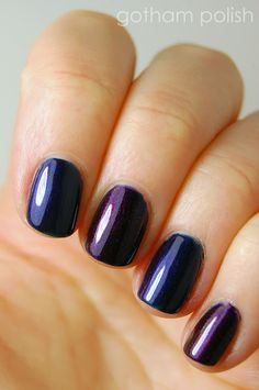 Chanel Taboo (middle and pinky fingers) vs OPI Russian Navy (pointer and ring fingers)