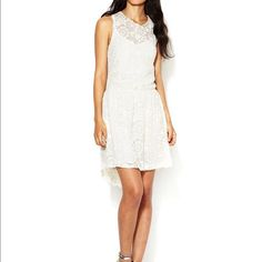 White lace dress Embroidered lace throughout. Gathered at waist. Lined. 65% cotton, 35% nylon. New with tags. Sam & Lavi Dresses