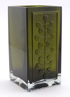 Lucullus is a square vase of molded blown glass designed by Nanny Still for Riihimäen Lasi in 1966.  There are 9 different molded designs in the Lucullus series. It was in production 1967 – 1968 and was made in many colors including clear, yellow, blue, green, purple and brown. It is also some times referred to by its design number, #1494