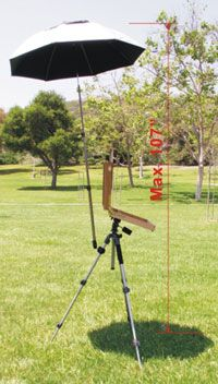 """EASyL umbrella is clamped to the tripod leg  designed so that it will lift off is hit by a gust of wind.  Large ventilation openings to counteract wind drag.  Umbrella diameter: 45 inches (cross). 48"""" (arc). The overall length is 26"""" when folded.   Universal ball joint  directional adjustment.  Rubber padded C clamp can be mounted to any tripod leg  Strong fiberglass umbrella frame  Large Nylon carry bag carries entire kit.  Lightweight design - Apr. 2.2 lbs. Artwork Essentials $94.99"""