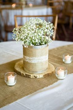 Simple rustic centerpieces can be the perfect wedding addition. Use a slice of . Simple rustic centerpieces can be the perfect wedding addition. Use a slice of a tree, burlap, lace, and baby's breath f. Burlap Wedding Centerpieces, Wedding Table Decorations, Bridal Shower Decorations, Wedding Burlap, Wedding Rustic, Tin Can Centerpieces, Shower Centerpieces, Perfect Wedding, Our Wedding