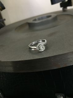 White gold and diamond engagement ring with custom made fitted eternity band.