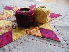 I think I am ready to try my hand at hand-quilting...something like this, possibly?