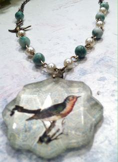 Bird Necklace: $34 (+ shipping)  Design & Handcrafted by Rachel's Originals: Jewelry So Adorable It's ADORNable  TO ORDER: Please visit my FB and/or Esty pages at the following links!   www.facebook.com/RachelsOriginals  www.rachelsoriginalgifts.etsy.com  *The chain is made from soldered links & is accented by jade beads as well as a little sparrow bird connector*