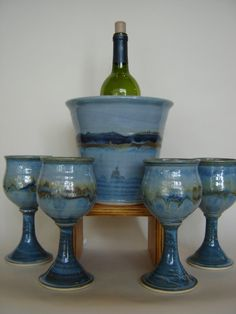 This is beautiful...a wine set in your choice of colors...San Antonia Pottery San Antonia, Florida http://www.sanantoniopottery.net/jupgrade/index.php/pottery-display/wine-set-rutile-detail