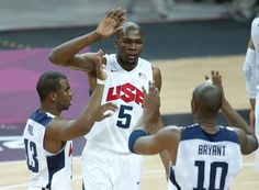 USA's Kevin Durant (5), Chris Paul (13) and Kobe Bryant (10) react during the first half of a preliminary men's basketball game against France at the 2012 Summer Olympics, Friday, July 27, 2012, in London