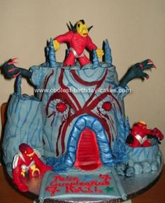 HomemadeGormiti Fire Mountain Volcano cake: A friend's son is into Gormitis so I looked them up on the internet and decided to do Fire Mountain, the Lords of Lava's fortress.   I made 4x20cm chocolate