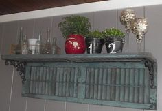 A shelf from old shutters. I think I'm going to do this in the back with the shutters I just took off the front of the house!