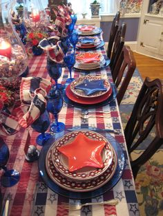 The Tablescaper: Patriotic Dinner Party --  LOVE the Dollar Store Star Shaped salad plates!  Not to mention the Dollar Store cobalt blue shot glass shrimp cocktail plates...