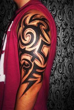 Tribal Sleeve Tattoo - http://16tattoo.com/tribal-sleeve-tattoo-2/