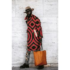 Well hello - so stylish! What do you think? Found on #Pinterest. Please tag #model or #photographer if you know them!  #africainspired #africanfashion #africanprints #africanfabrics #menswear #coat #style #streetstyle #blackmen