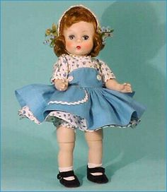 Dolls for Late Summer #366 of 1957 is a bending knee walker. cotton dress and bloomers. The white straw bandeau ha