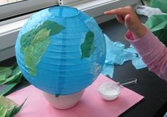 Gluing on the tissue paper for paper lantern planets