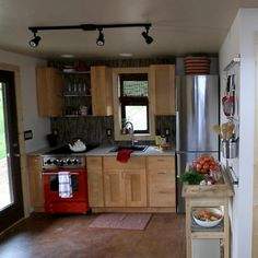 Tiny homes can have a full kitchen with all the appliances of larger homes, add a small island on wheels for additional counter space that can easily be positioned out of the way when not used.
