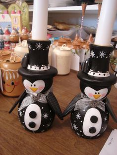 A pair of Penguin Candleholders in Black & White
