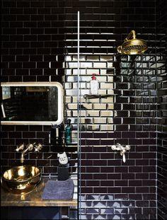 Black subway tile on shower and bathroom walls