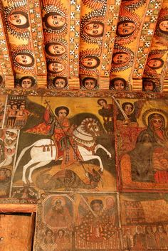 The Absolutely Mind-Blowing Painted Interior of Debre Birhan Selassie Church in Ethiopia. Murals on the walls depict the heroism of Saint George, scenes from the Passion, various other figures from the Bible including Satan, and the ceiling of Selassie Church is covered at its apex with dozens of angel heads that gaze down upon all with what appears to be quiet joy and a kind of mischievous curiosity.
