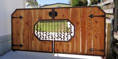 Secret Garden Gate. Wood and steel gate with decorative leaf feature from Charlton & Co.