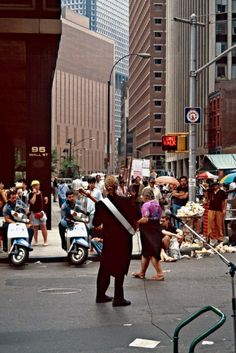 Far from the overloaded Electra Glide we're used to seeing cops zooming around on, here's two NYPD officers astride what look like Yamaha Riva 125s taking in some groovy street music in 1971