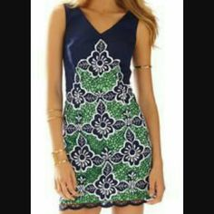 Lilly Pulitzer Sylvie Jungle Flowers Shift Dress Exquisite Sylvie Shift Dress in Jungle Flowers True Navy pattern. Dress has a V neck and it is fully lined. The hem is a lace scalloped edge embroidered in white with navy and green contrasting colors. This dress is a true gem. (Image from Lilly Pulitzer). Lilly Pulitzer Dresses