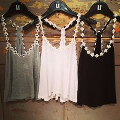 Living in our daisy tanks? We are too with all of our daisy embellished three color way tanks