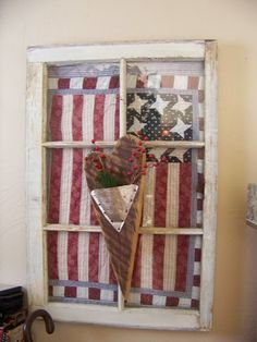 quilted flag behind a pane window