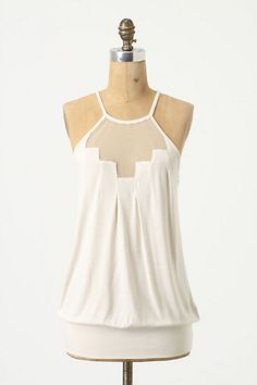 anthro - staggered gleam top. geometric pattern is strong and feminine.