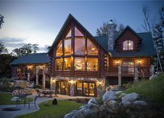 Traditional meets modern with wood and vast areas of glass in this log home.
